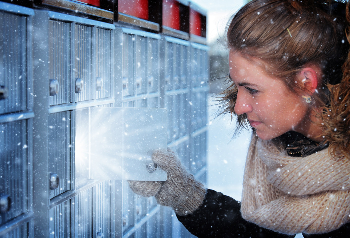 Pretty Woman Looking at Highlighted Mailbox in Winter - Stock Photos, Pictures & Images
