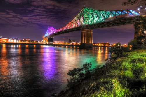 Colorful Jacques Cartier Bridge in Montreal City during Covid 19 - Stock Photos, Pictures & Images